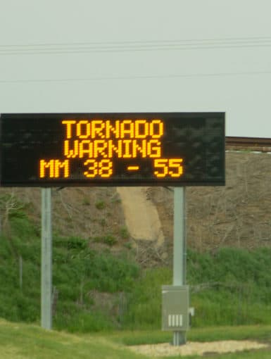 A sign on the Kansas Turnpike showing an active tornado warning on May 19, 2013