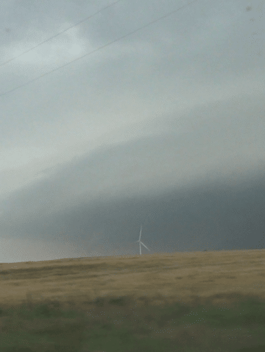 Lots of energy coming out of the El Reno supercell. Video capture from the south looking across wind farm near Union City