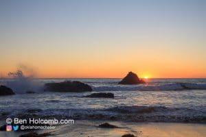 Waves crash into the rocks along the pacific coast near San Simeon, CA