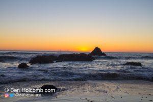 Waves crash along rocks near San Simeon, CA