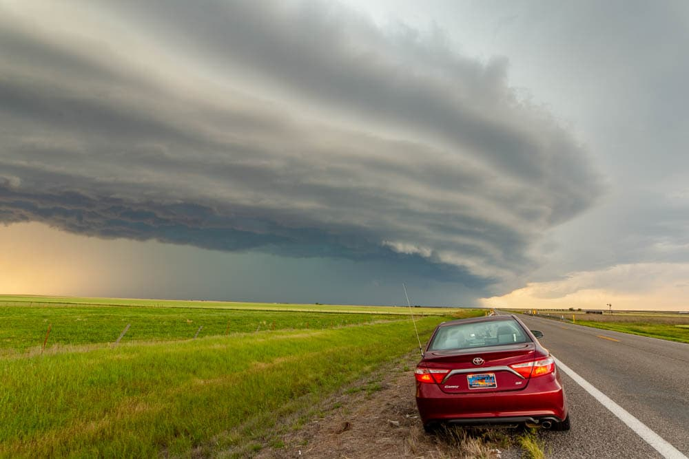 My Toyota Camry in front of a shelf cloud while chasing in May 2020