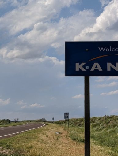Welcome to Kansas sign with a developing LP Supercell