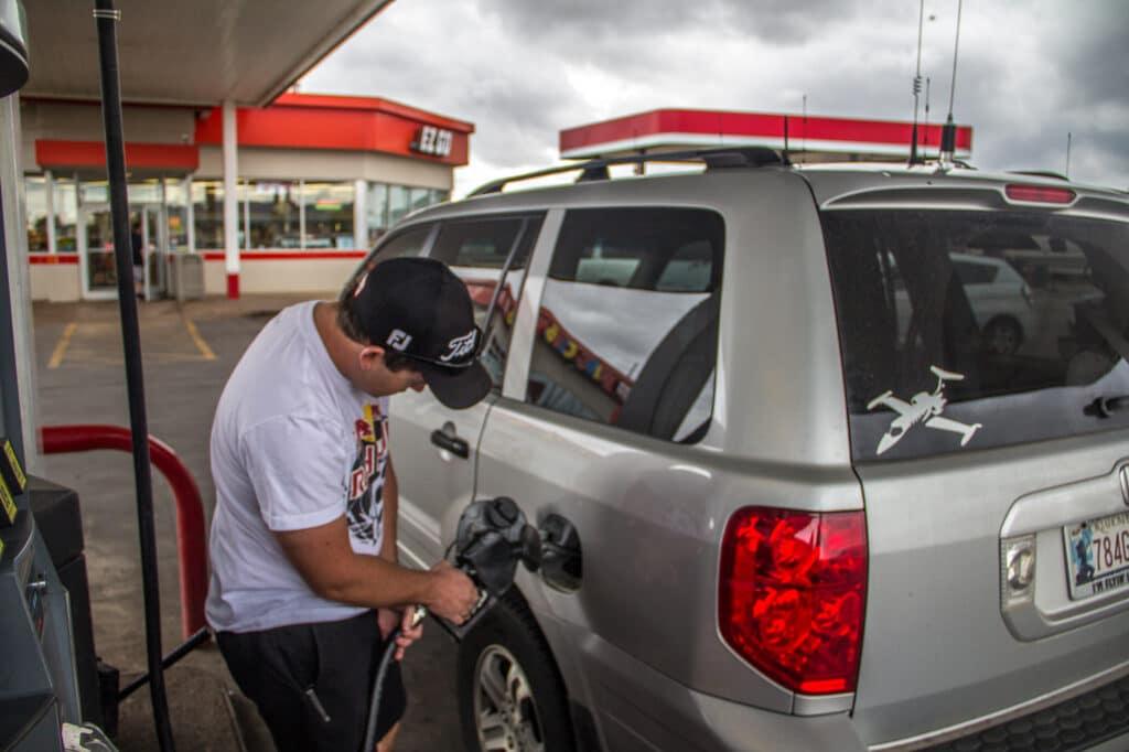Cory filling up his car in Altus
