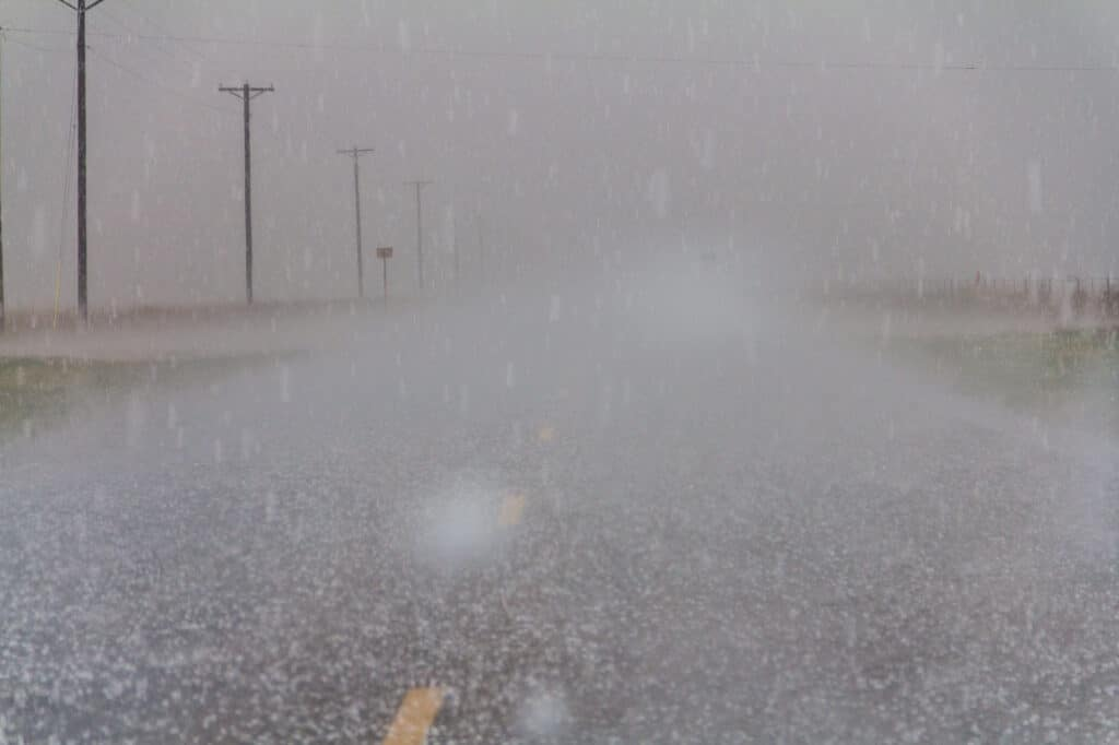 Hail falling and covering the road in Texas