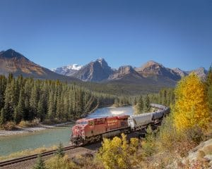 A Canadian Pacific Train travels through Morants Curve in Banff National Park on a sunny day in September 2017