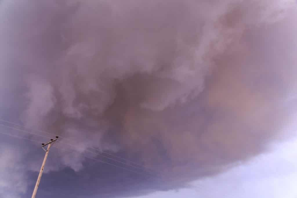 Red dirt from updraft mixing into the mesocyclone