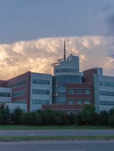 A storm looms over the National Weather Center, April 25, 2017