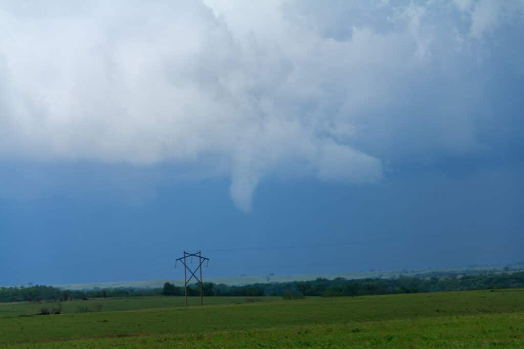 Small funnel that later turned into a very brief tornado
