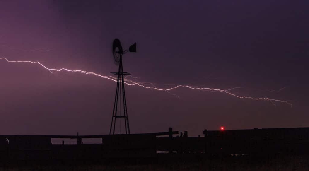 Lightning behind a windmill