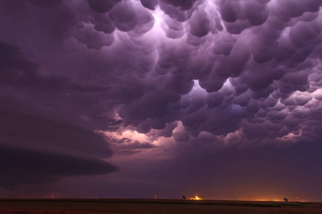 Mammatus clouds with shelf cloud stack
