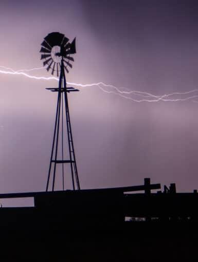 Lightning strikes behind a windmill in Western Oklahoma