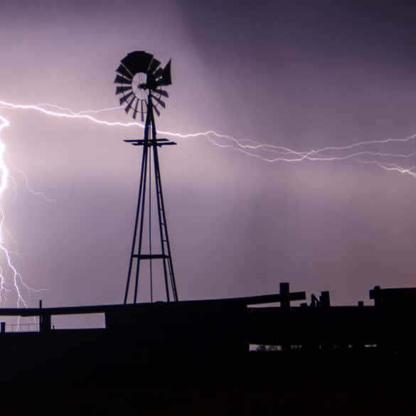Lightning strikes behind a windmill in Western Oklahoma