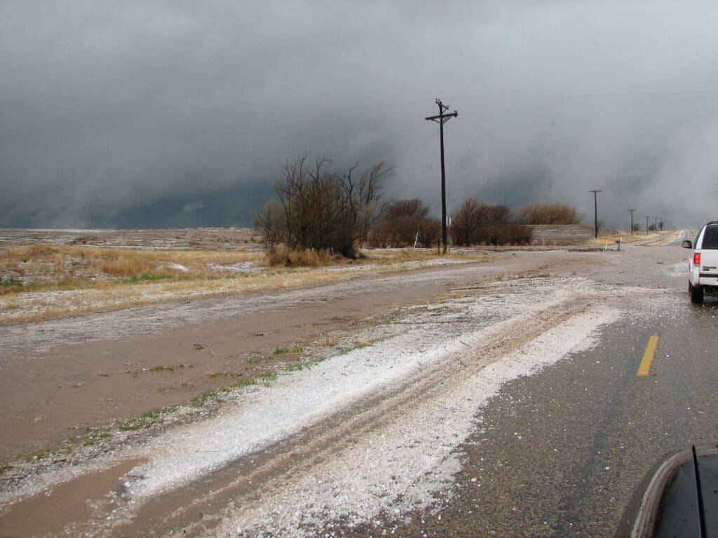 Hail covering the road near Tulia
